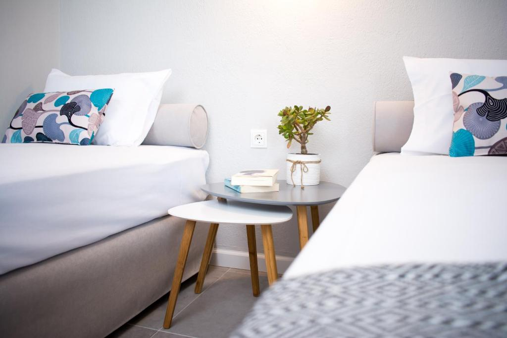 A bed or beds in a room at Avgerou Studios and Apartments