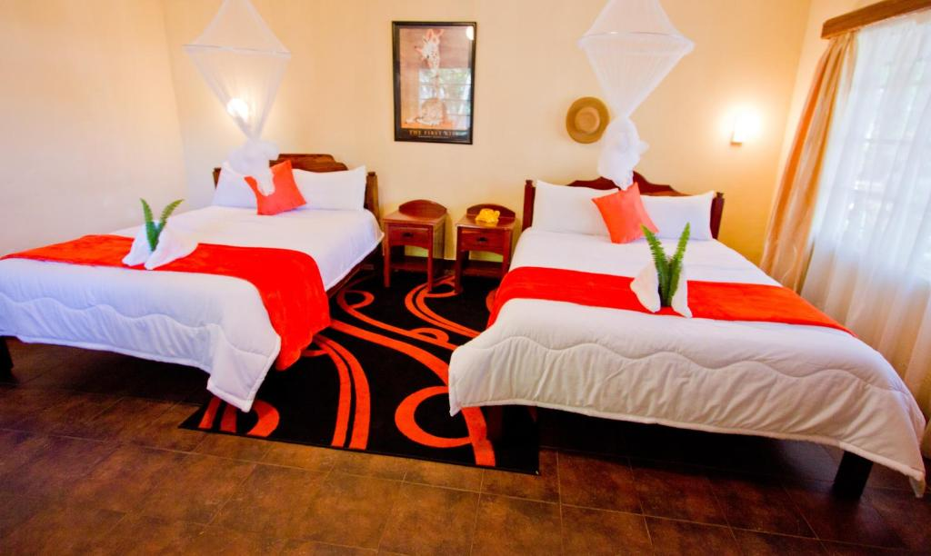A bed or beds in a room at Chanters Lodge