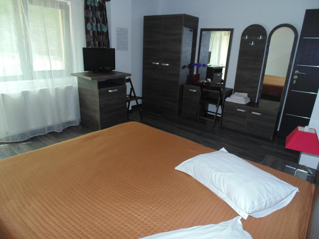 A bed or beds in a room at Eden Maison