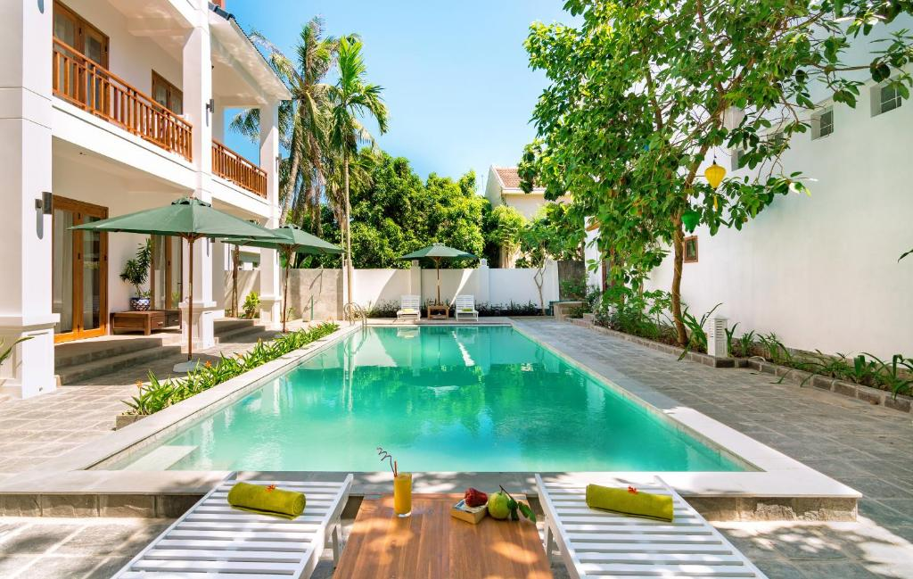 The swimming pool at or near Fig Tree Boutique Villa