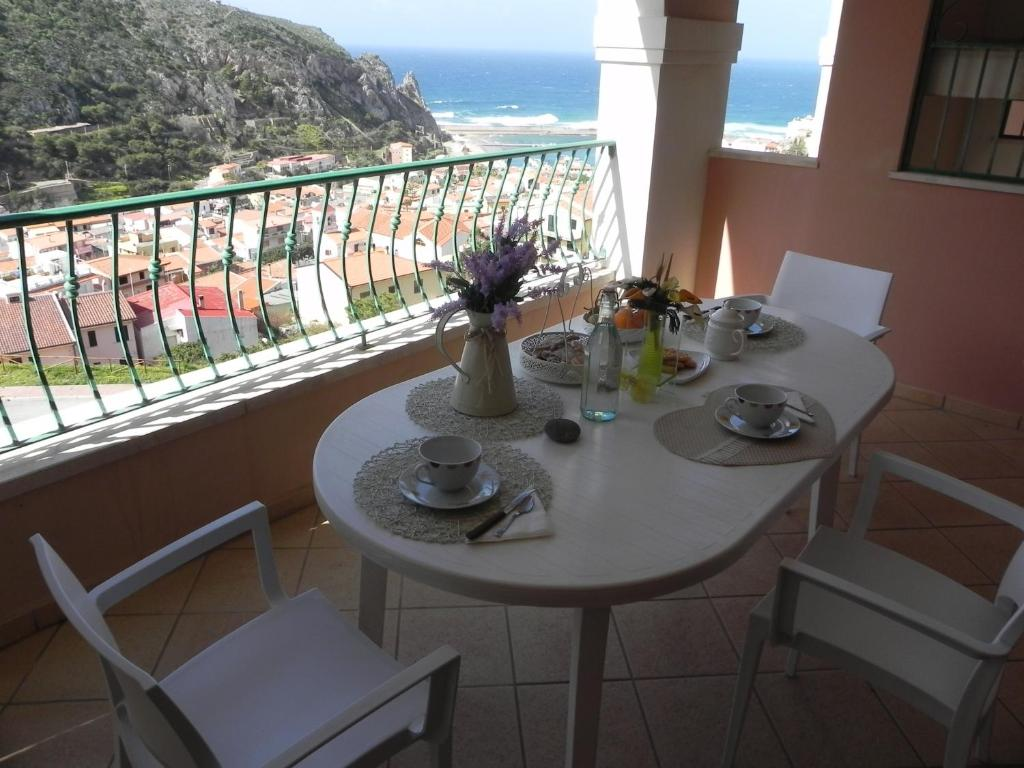 A balcony or terrace at Buggerru a Mare Residence