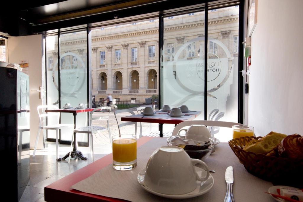 Restaurant ou autre lieu de restauration dans l'établissement Hotel de L'Opéra