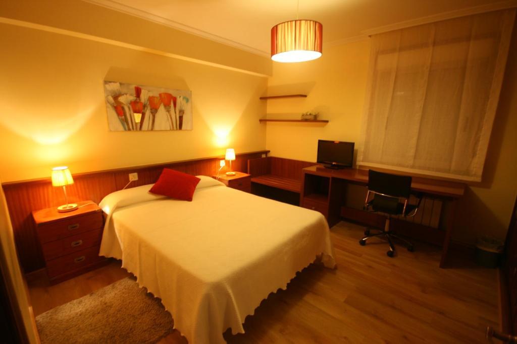 A bed or beds in a room at PR La Paz