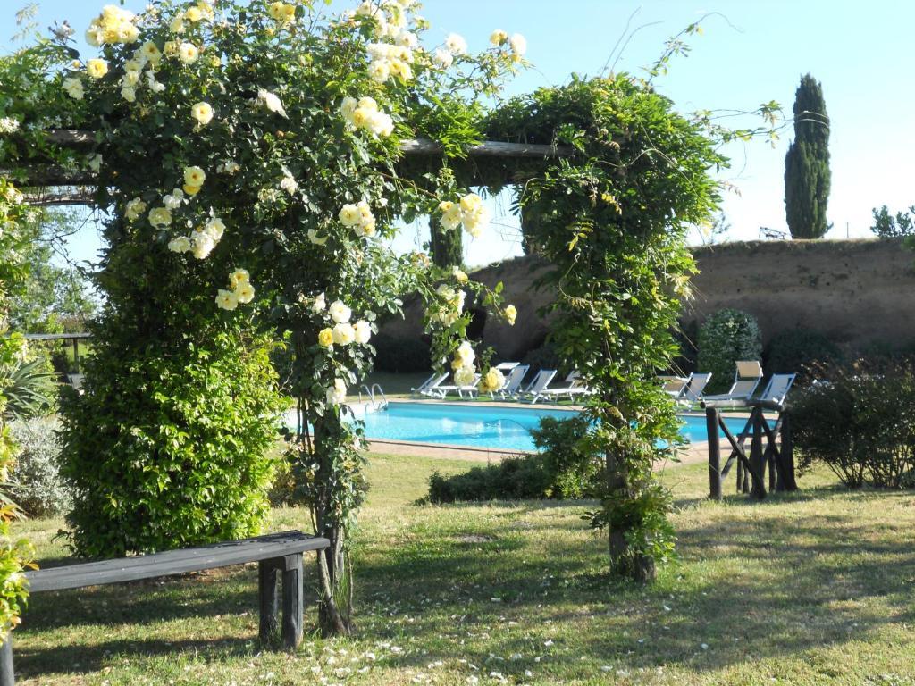 The swimming pool at or near Locanda Rosati