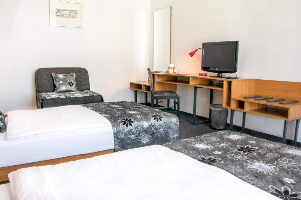 Un ou plusieurs lits dans un hébergement de l'établissement Hotel Delminivm
