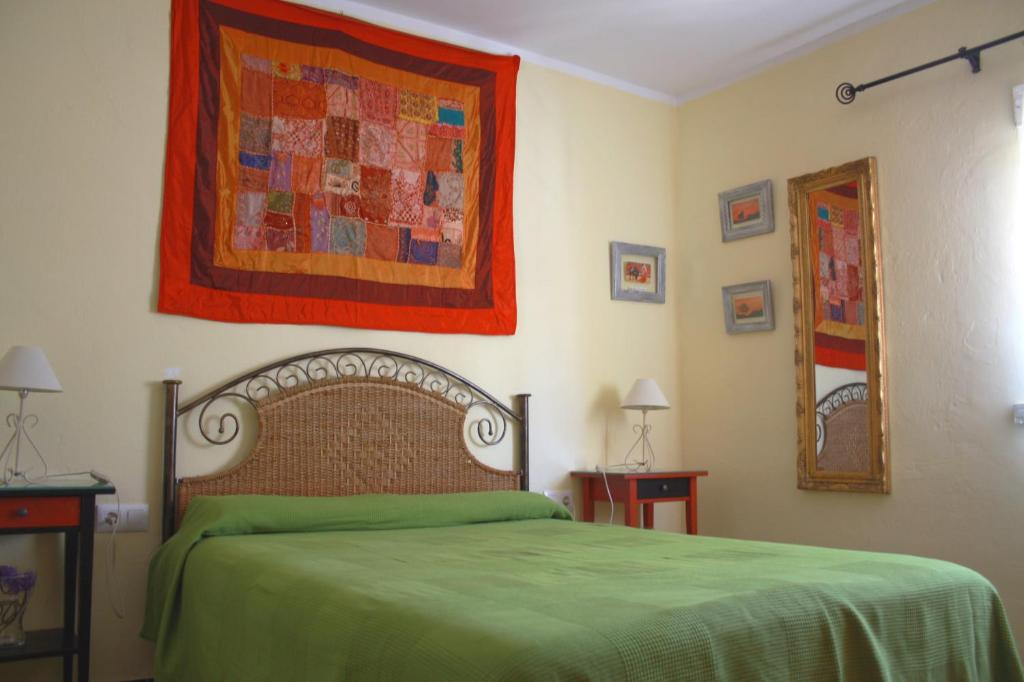 A bed or beds in a room at Casa Lomas