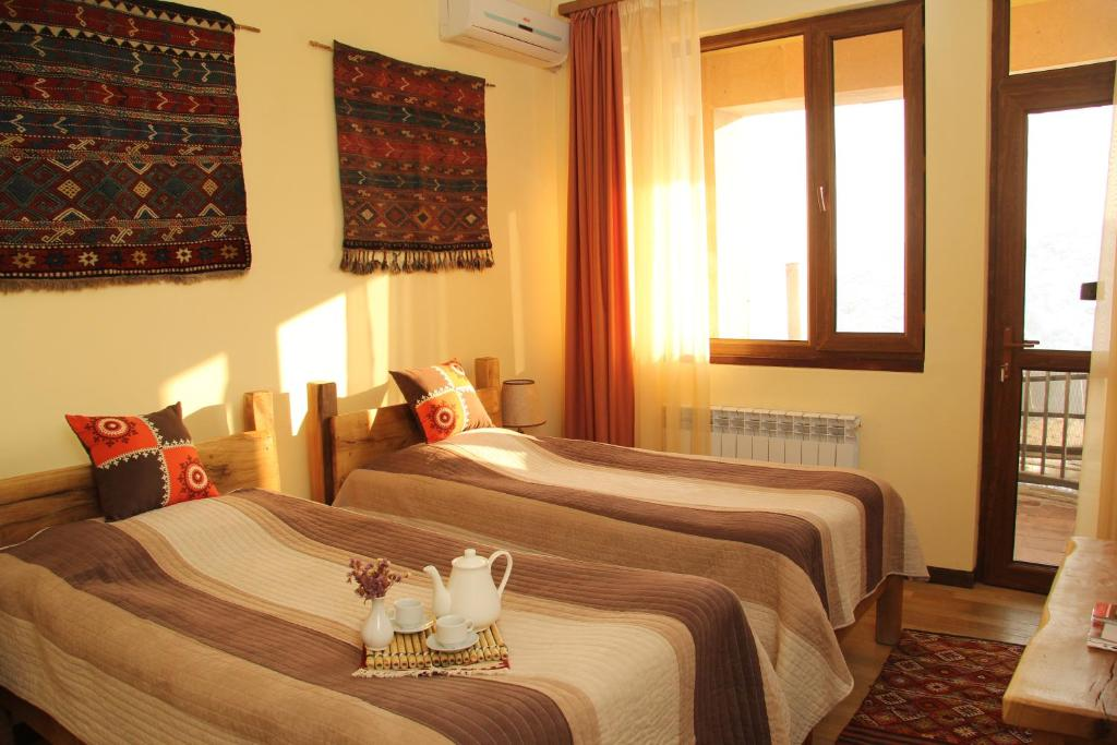 A bed or beds in a room at Silk Road Hotel