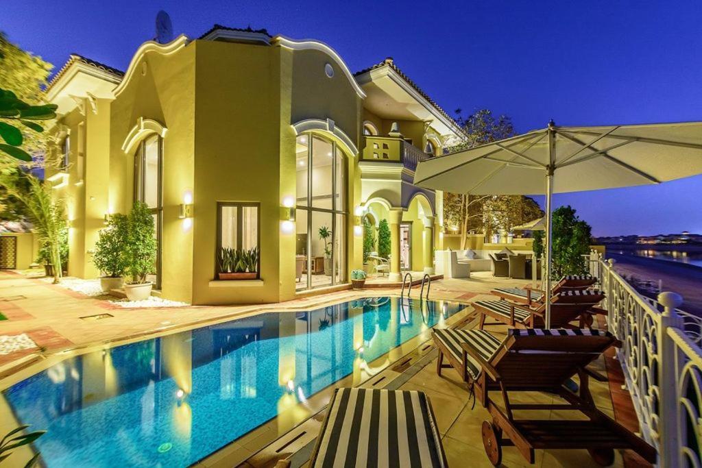 Signature luxury holidays four bedroom villa sandy bay for Luxury holidays in dubai