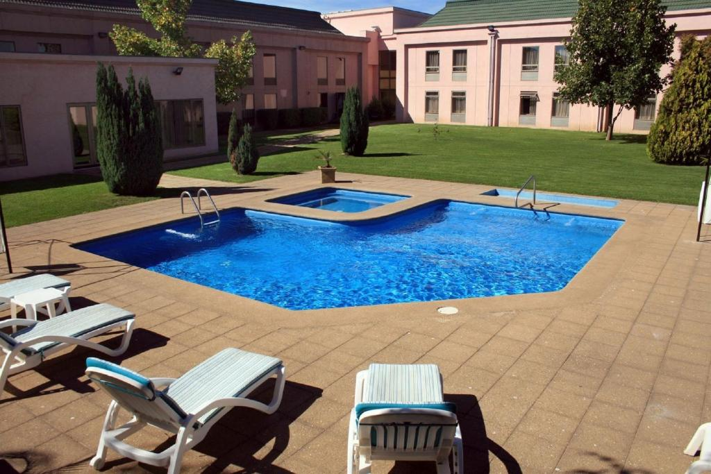 The swimming pool at or near Hotel Diego de Almagro Los Angeles