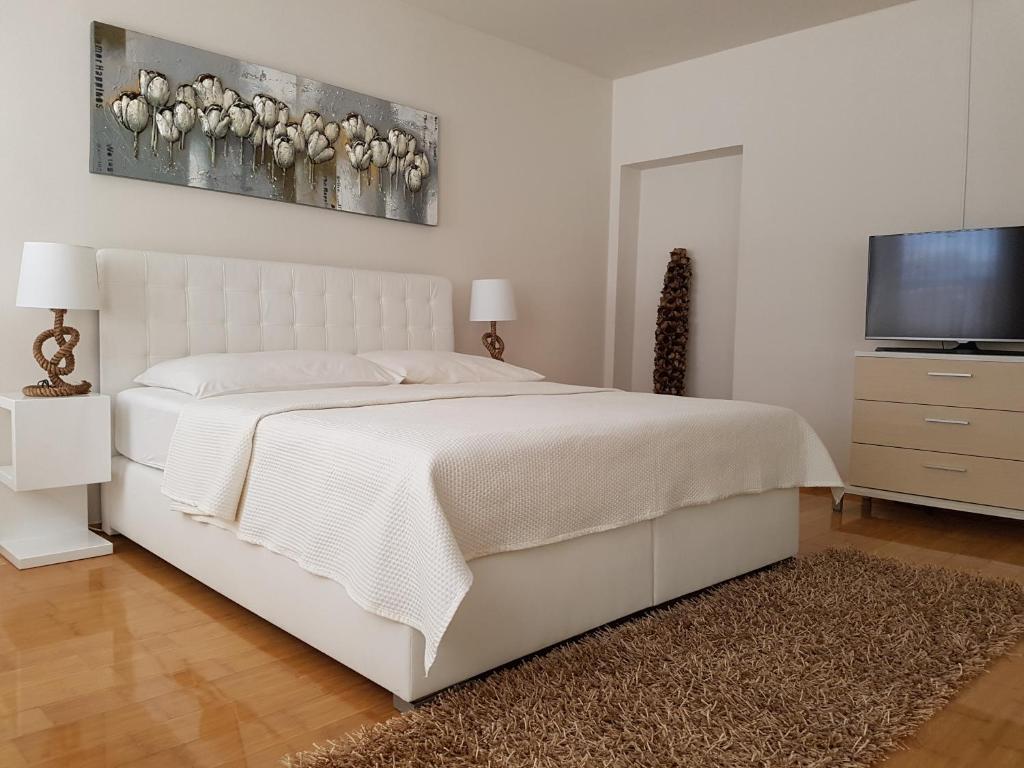 Letto o letti in una camera di Apartments Eleven