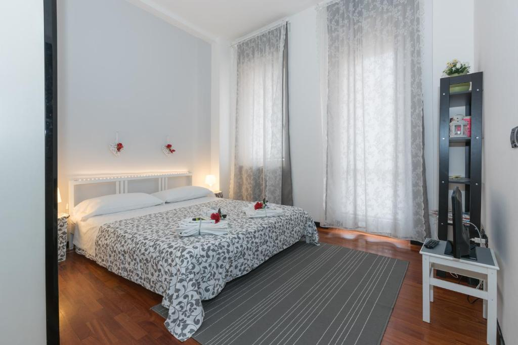 A bed or beds in a room at Residenza Vittoria City Center