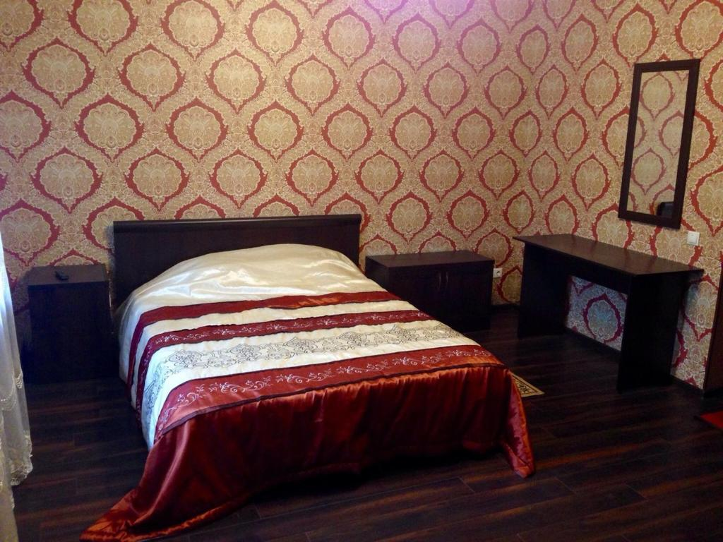 Кровать или кровати в номере Астория