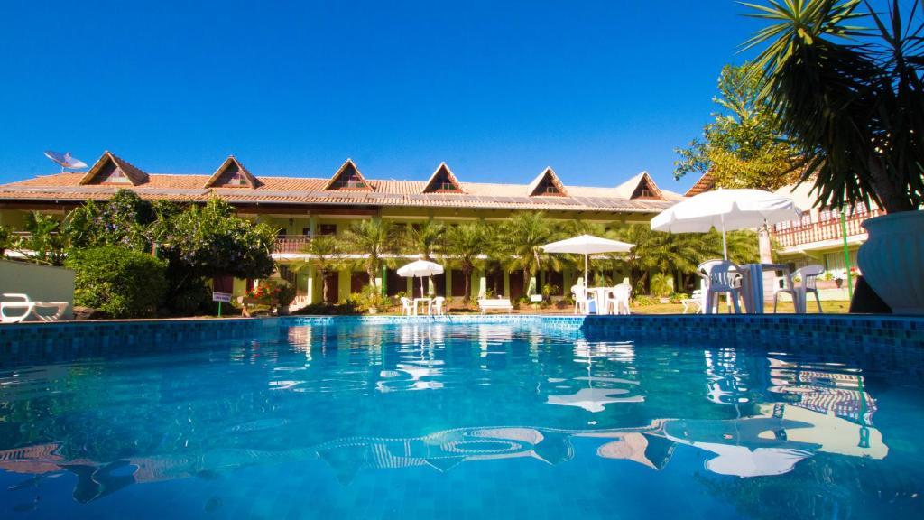 The swimming pool at or near Hotel Pousada Mandala