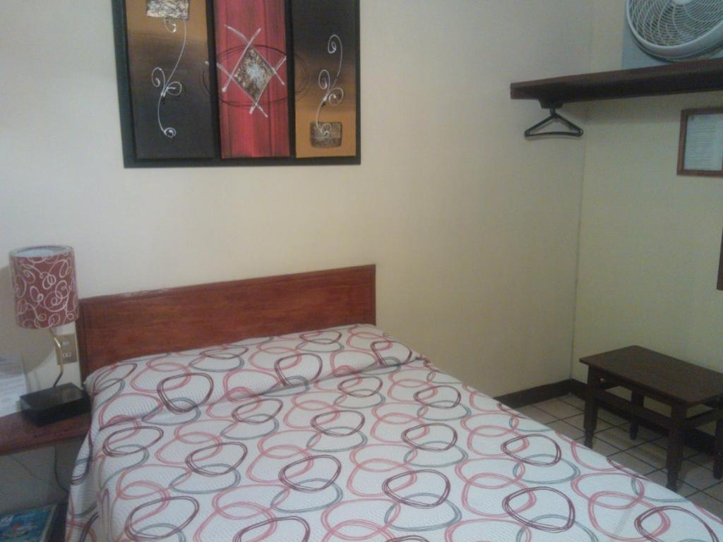 A bed or beds in a room at Hotel Topacio
