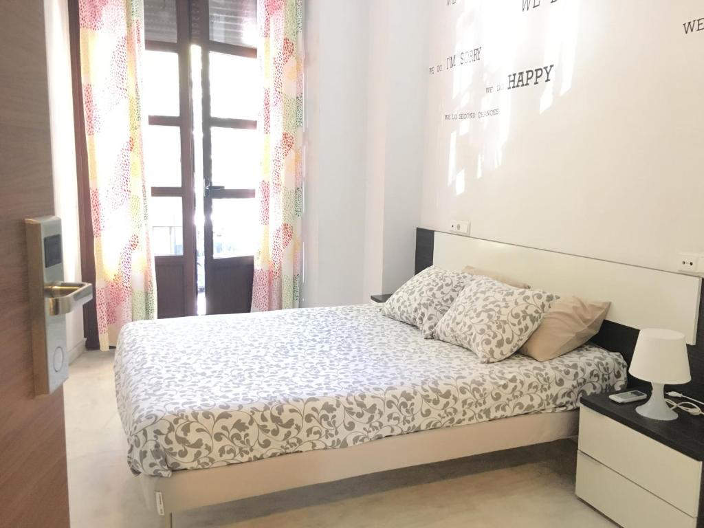 A bed or beds in a room at The Spot Central Hostel