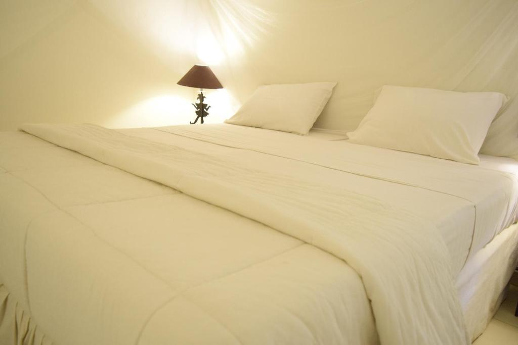 A bed or beds in a room at Fana Hotel