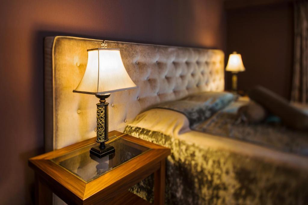 Кровать или кровати в номере Ventura Boutique Hotel