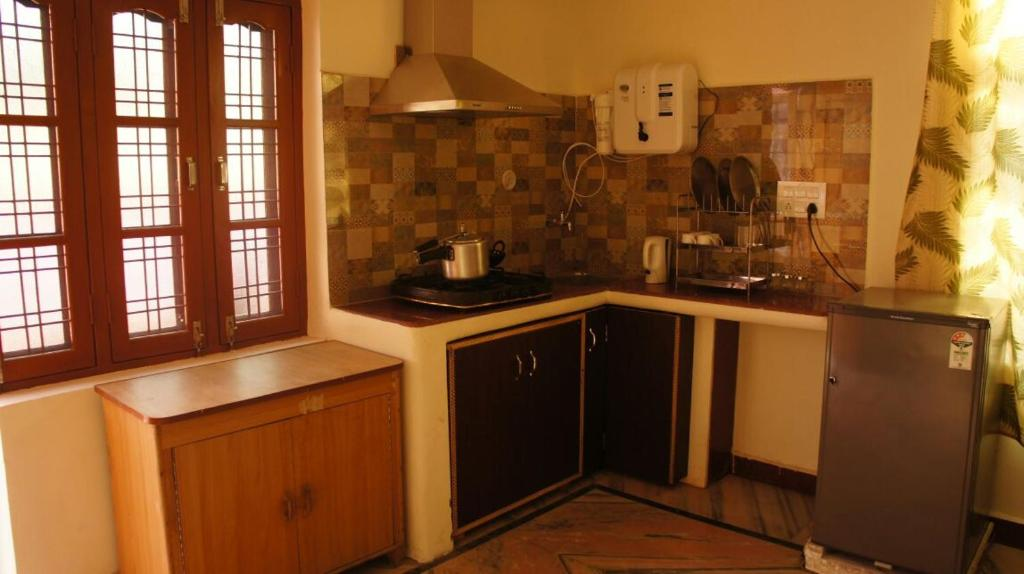 A kitchen or kitchenette at Harihar Niwas Homestay