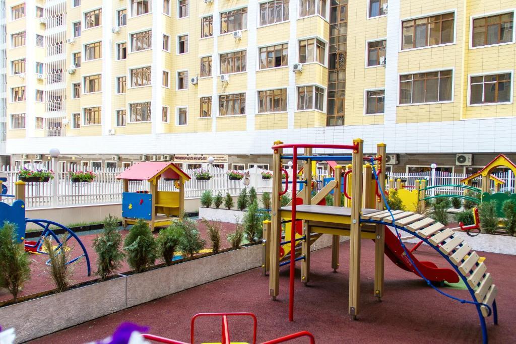 Children's play area at Квартира на Каирбекова