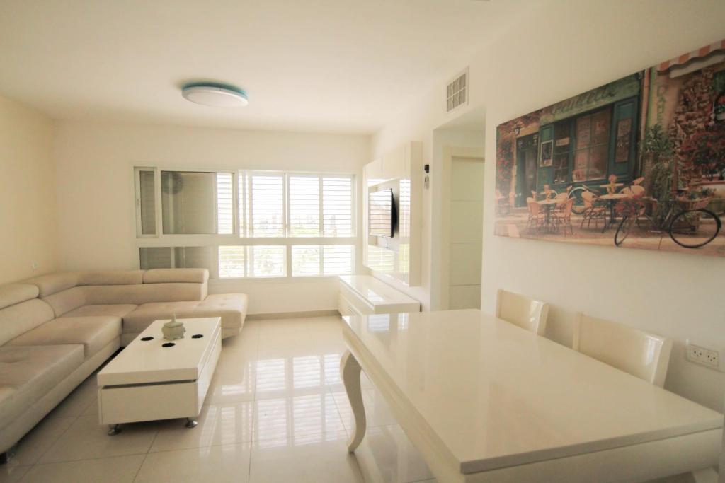 Ein Sitzbereich in der Unterkunft Beautiful 4 bedroom duplex apt