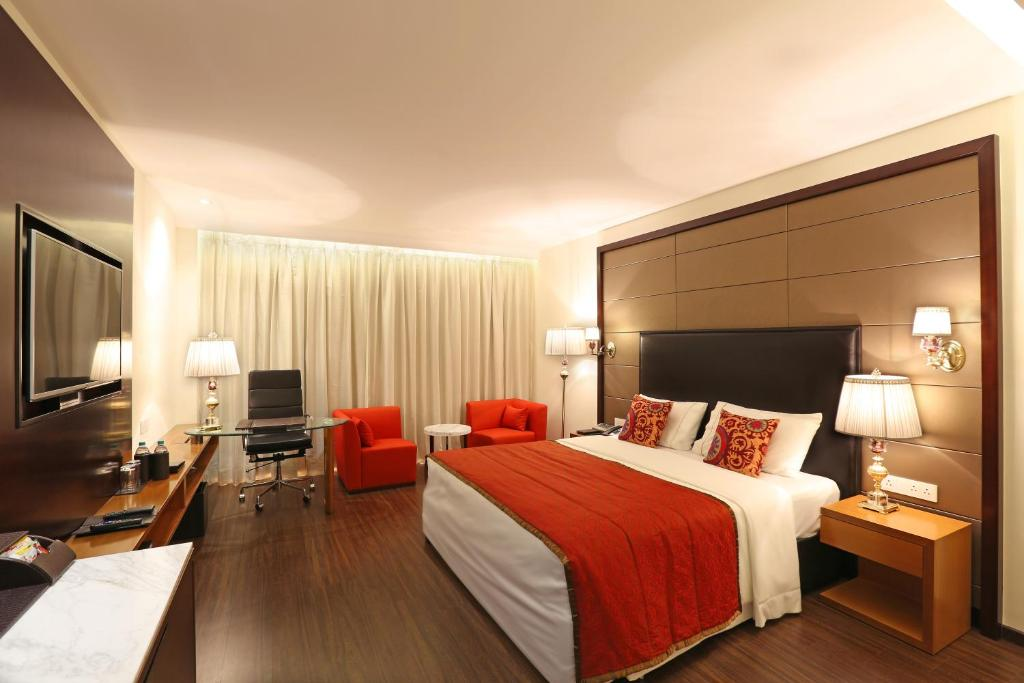A television and/or entertainment center at Samanvay Boutique Hotel