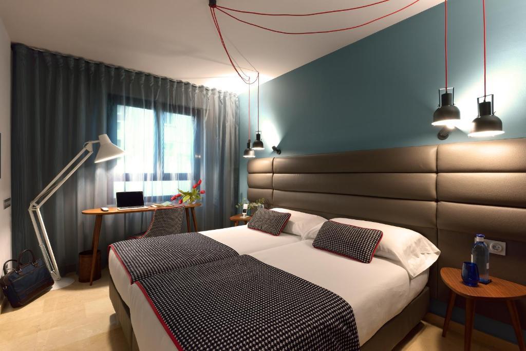 Cama o camas de una habitación en Hotel Pamplona Plaza