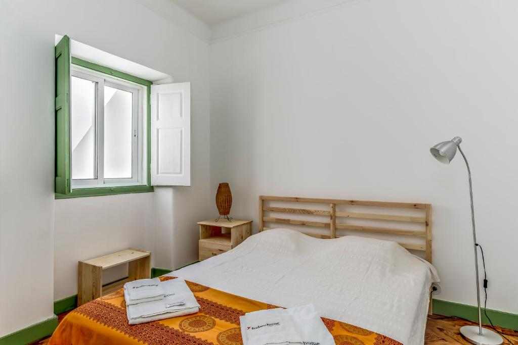 A bed or beds in a room at Feels Like Home Vila Real Santo Antonio Family House