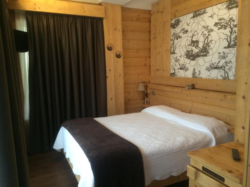 Säng eller sängar i ett rum på Chalet 1400