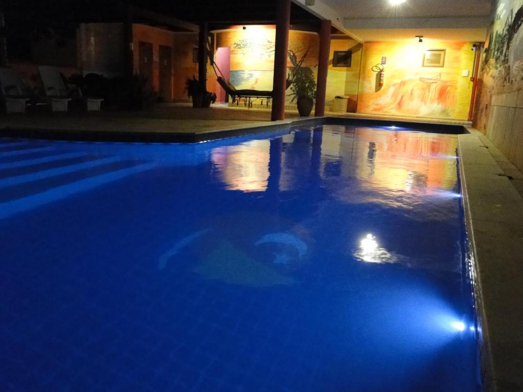 The swimming pool at or near Hotel Pousada Latitude