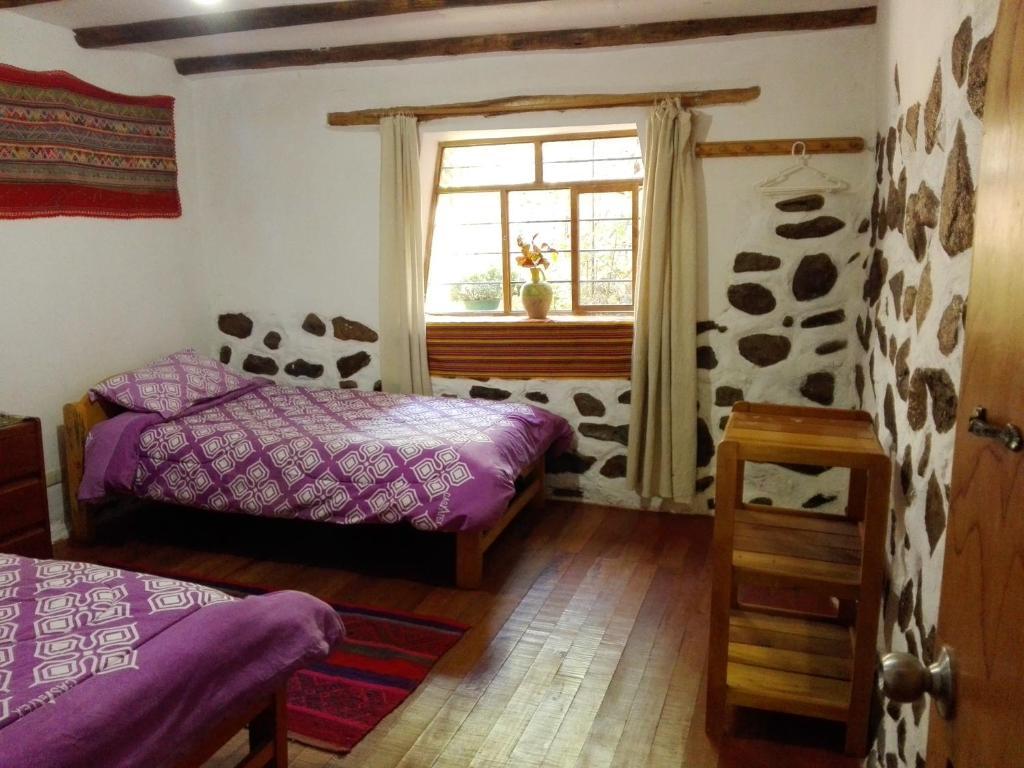 Un ou plusieurs lits dans un hébergement de l'établissement EColodge Ccatan
