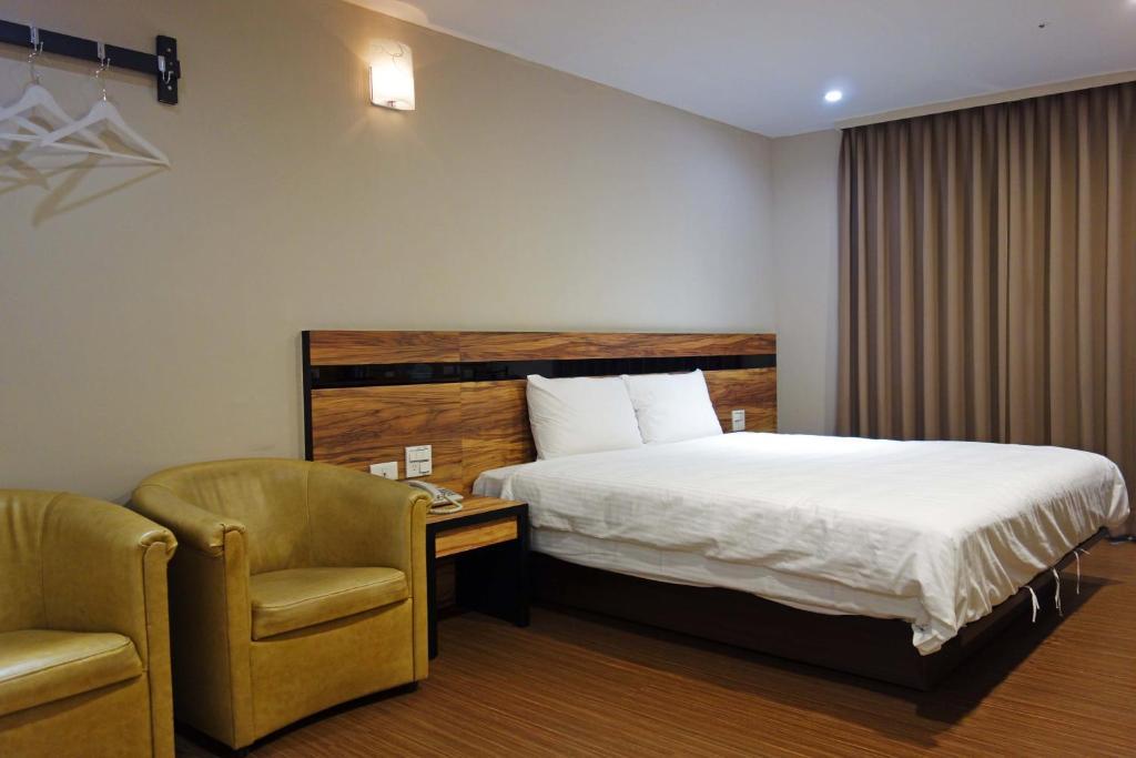 Letto o letti in una camera di TopL Hotel