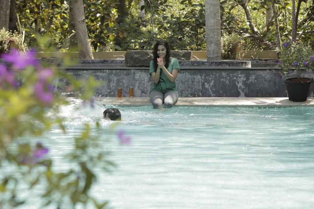 The swimming pool at or near Joys Resort Poovar