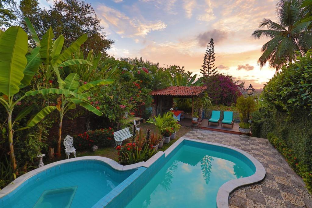 The swimming pool at or near Pousada do Amparo