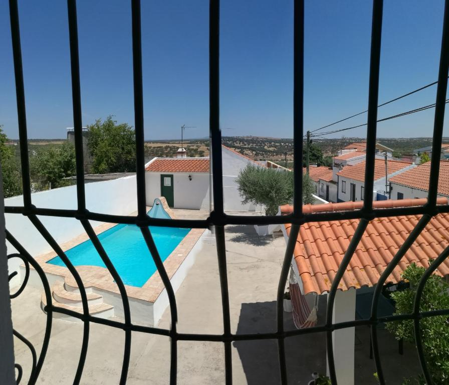 A view of the pool at Casa dos Grilos or nearby