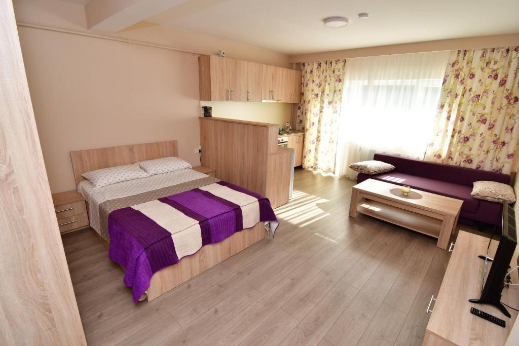 En eller flere senger på et rom på City Premium Apartments