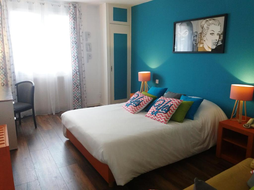 Un ou plusieurs lits dans un hébergement de l'établissement Hôtel De La Paix