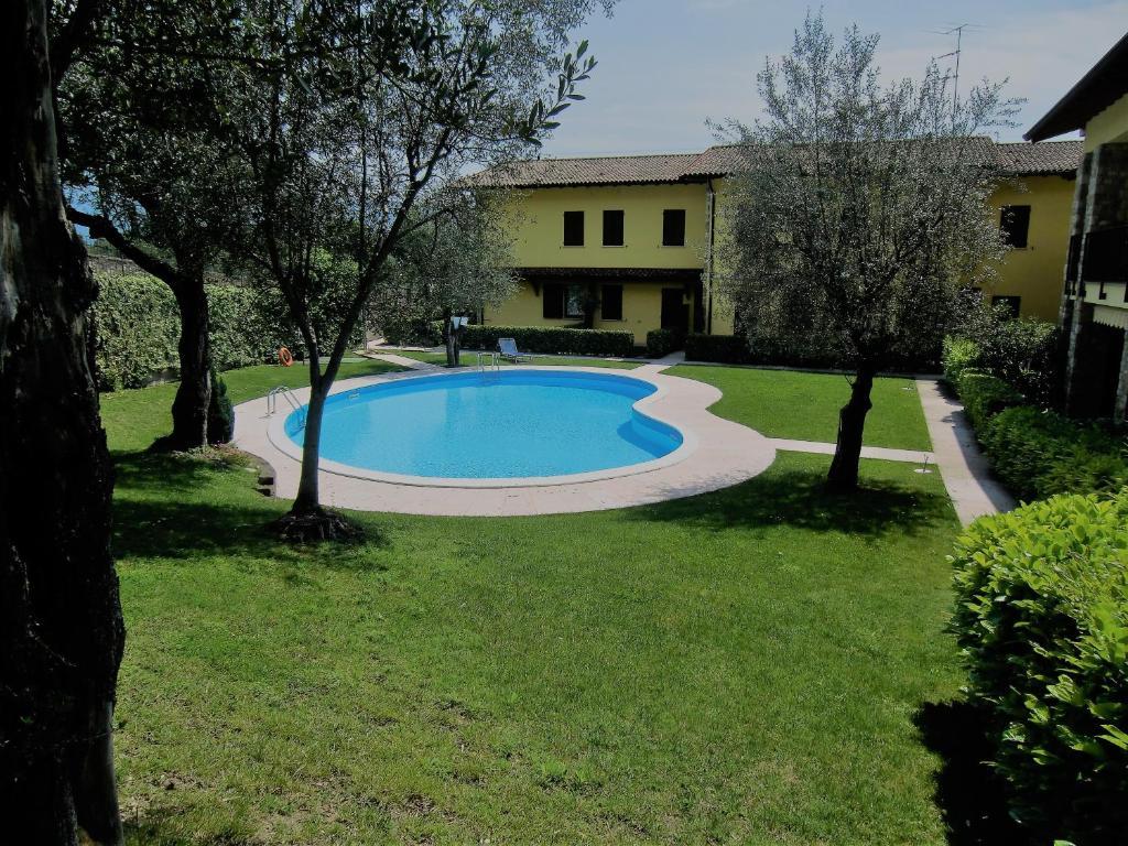 公寓Casa Olivella (義大利托斯科拉諾-馬德爾諾) - Booking.com