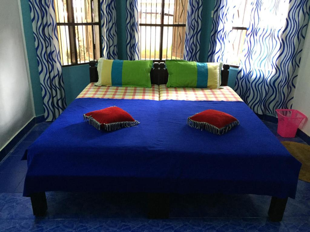 A bed or beds in a room at Mantra Heritage Home