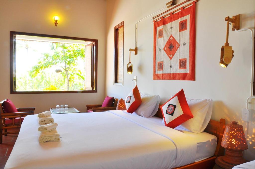 Cama o camas de una habitación en Jardin De Mai Hoi An