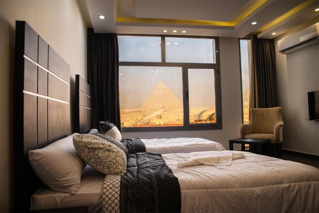 Marvel Stone Hotel tesisinde bir odada yatak veya yataklar