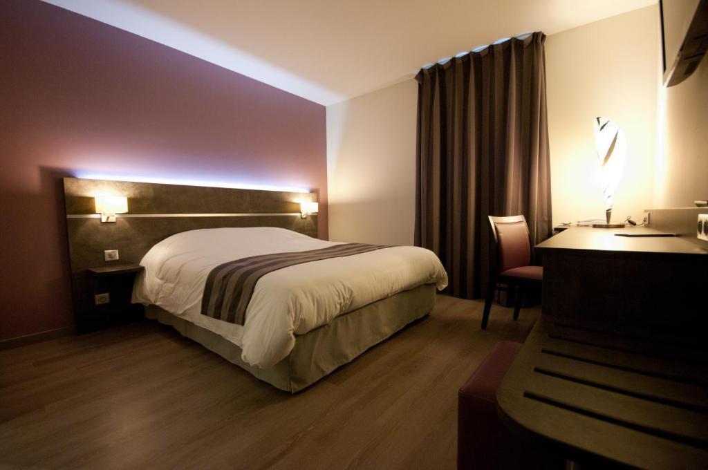 Un ou plusieurs lits dans un hébergement de l'établissement Brit Hotel Confort Saint-Dizier