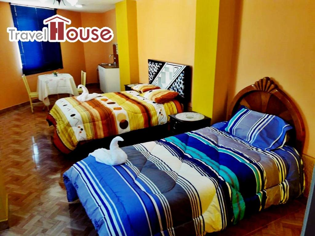 A bed or beds in a room at Travel House