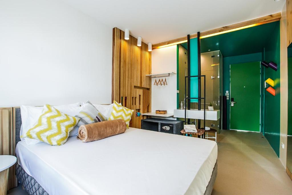 A bed or beds in a room at Hotel Covo