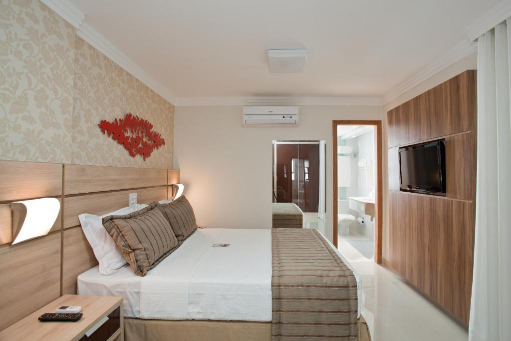 A bed or beds in a room at Bristol Jaraguá Hotel Pampulha