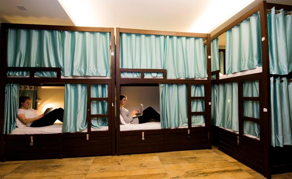A bunk bed or bunk beds in a room at Joey's Hostel