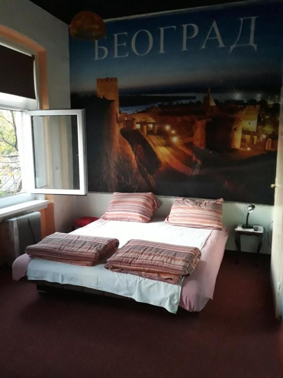 A bed or beds in a room at Apartments Kovac