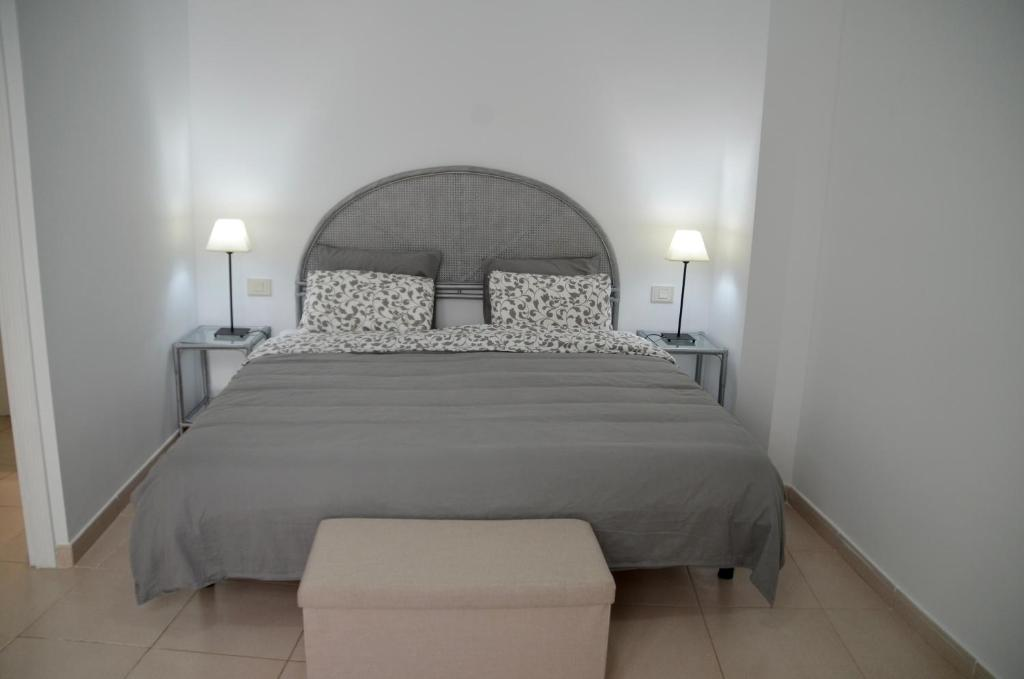 A Bed Or Beds In Room At Cozy Cute Apartment Beach