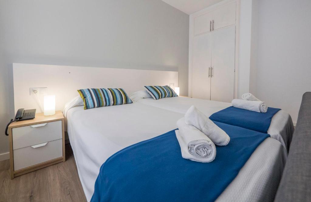 Ліжко або ліжка в номері Hotel Victoria