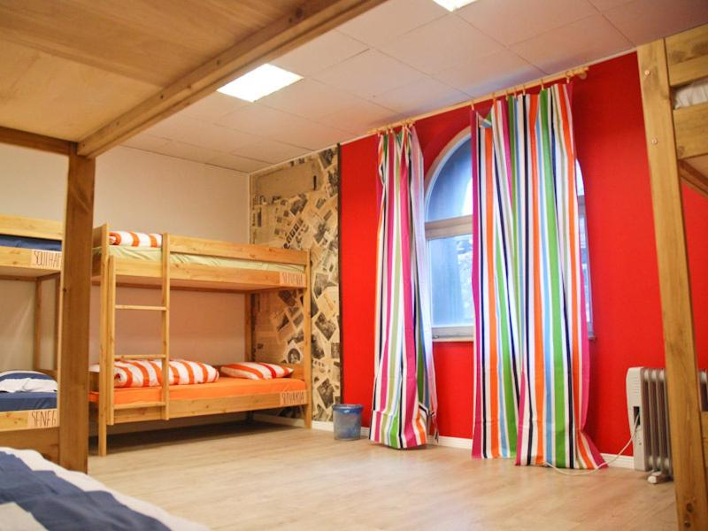 A bunk bed or bunk beds in a room at Red Emperor Hostel