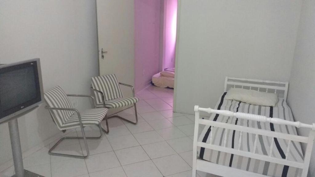 A seating area at Apartamento Praia da Costa